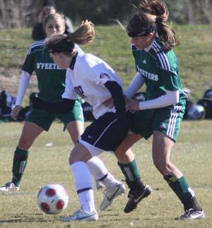 Elite girls club soccer players compete.