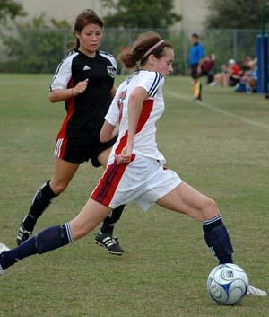 Girls club soccer players compete.