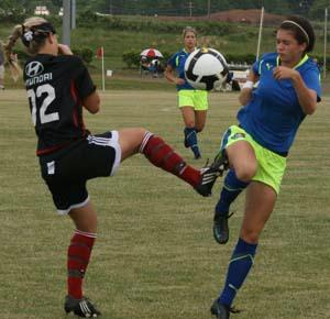 Elite girls club soccer players compete in a club soccer tournament.