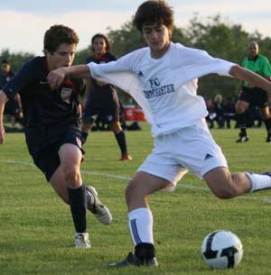 Boys club soccer players compete.
